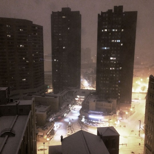 The Charles Towers and the intersection of E. Saratoga and N. Charles Streets in Baltimore are pictured as the blizzard blows through just after midnight on Jan. 23, 2016. Seen from the 23rd floor of the Embassy Suites. (Christopher T. Assaf/Baltimore Sun)