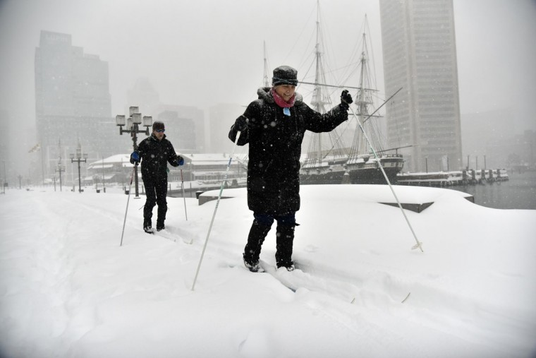 Erica Sibinga and her husband, Ken Hilker, of Federal HIll, take a tour around the Inner Harbor on cross country skis Saturday morning. (Kim Hairston/Baltimore Sun)