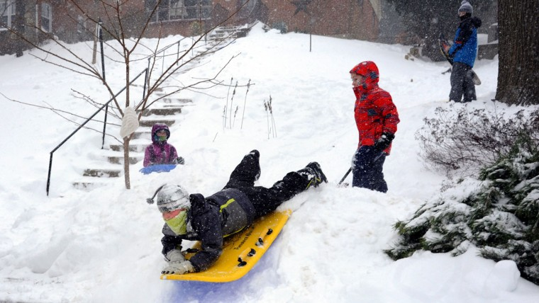 Enjoying the Blizzard of 2016 on the McCloskey front lawn in the Anneslie neighborhood are from left: Sydney McCloskey; Jaden Coyle, 11 (yellow sled); Colin McCloskey, 7 (red jacket); and Bennett Chambers, 11. (Algerina Perna / Baltimore Sun)