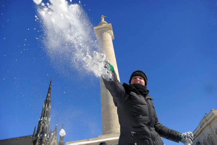 Hundreds of people participate in a snowball war at the base of Baltimore's Washington Monument in Mount Vernon on the first day since a powerful nor'easter snowstorm hammered the east coast. (Karl Merton Ferron / Baltimore Sun)