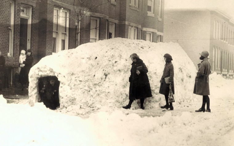 Jan. 27, 1922 -- Men make a shelter out of a pile of snow following the 1922 storm. (Baltimore Sun)