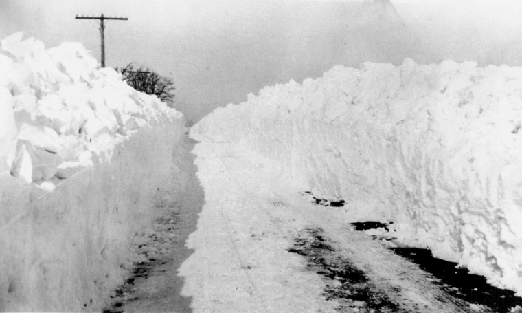 Jan. 27, 1922 -- Plowed snow creates walls along a road following the storm in 1922. (Baltimore Sun)