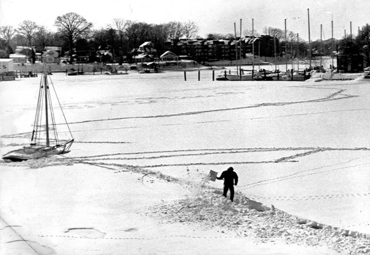 Feb. 20, 1979 -- This boat owner took to the shovel to get to his boat on Spa creek in Annapolis. He had to shovel about 200 feet through snow almost 2 feet deep to get there. There is a lifeline between the boat and shore just in case. (Baltimore Sun)