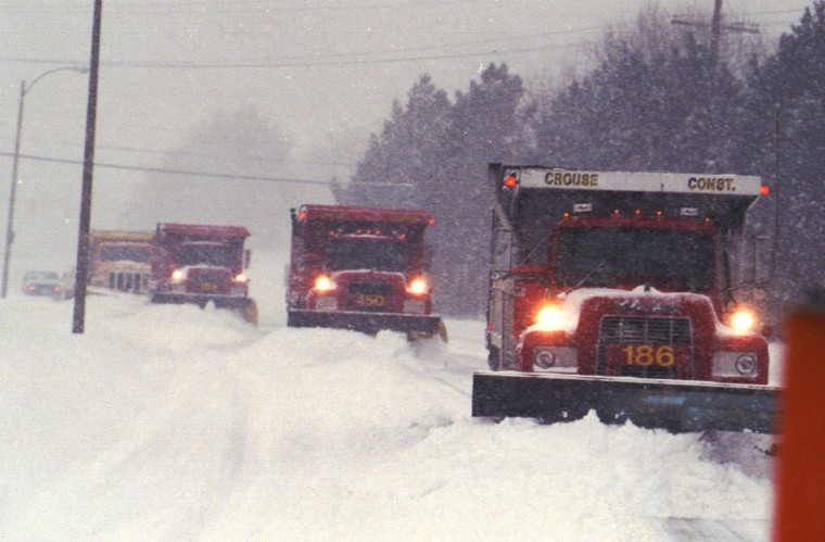 Trucks from the Baltimore County Snow Emergency Center plow roads in Towson during the Blizzard of '96. (Algerina Penra/Baltimore Sun)