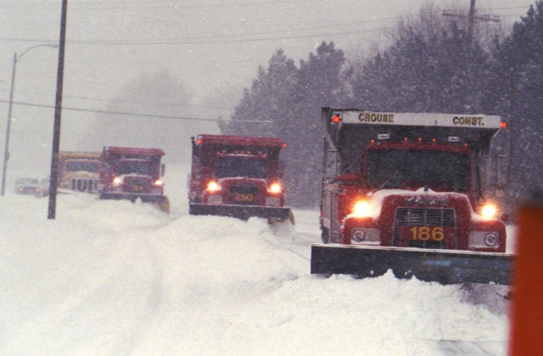 January 7, 1996  --Trucks from the Baltimore County Snow Emergency Center plow roads in Towson during the Blizzard of '96. (Algerina Penra/Baltimore Sun)
