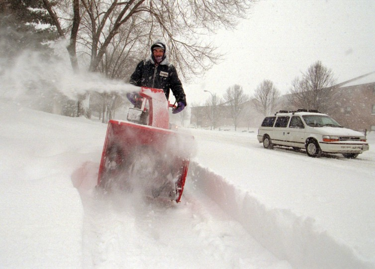 January 7, 1996  -- Richard Von Postel, of Cockeysville, operates a snow blower to clear a sidewalk near the Town and Country apartment complex. Von Postel works for the apartment management company.  (Kenneth K. Lam/Baltimore Sun)