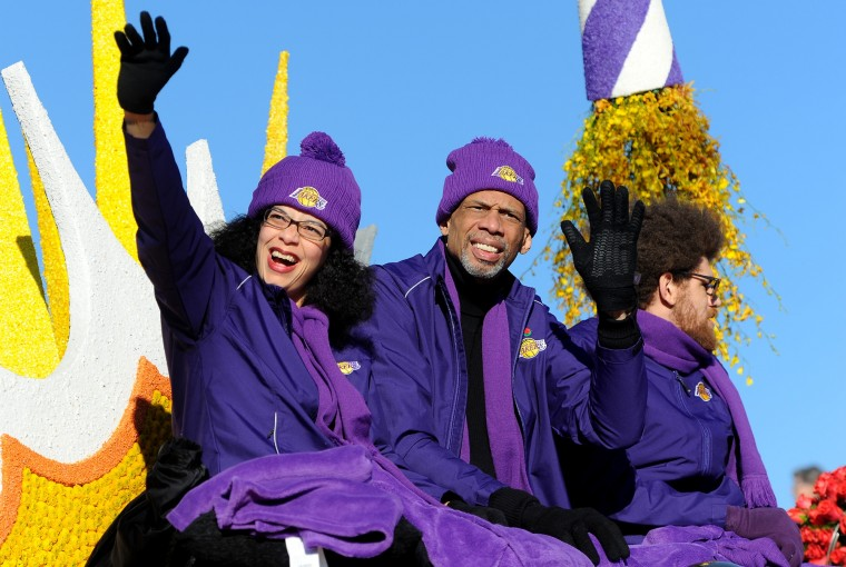 "Laker legend Kareem Abdul-Jabbar, center, rides the Los Angeles Lakers ""Every Second is an Adventure"" float during the 127th Rose Parade in Pasadena, Calif., Friday, Jan. 1, 2016.(AP Photo/Michael Owen Baker)"