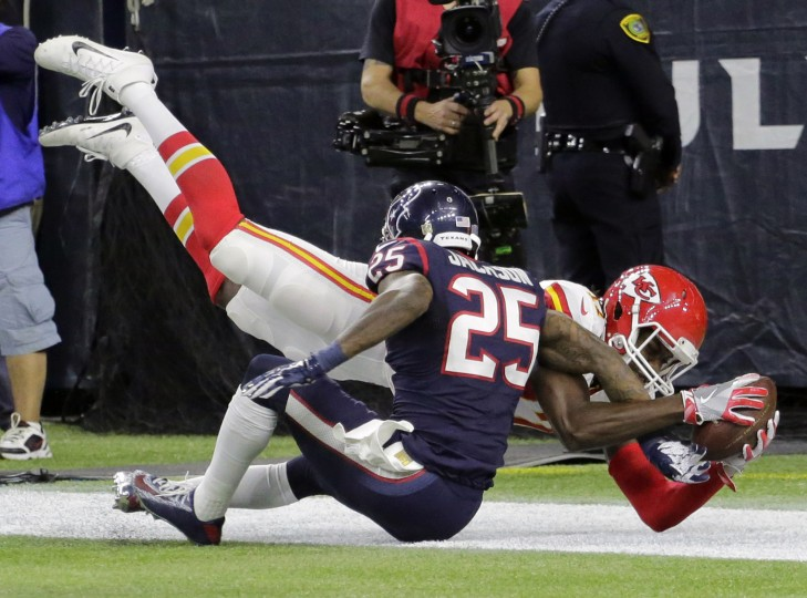 Kansas City Chiefs wide receiver Chris Conley (17) catches a pass for a touchdown over Houston Texans cornerback Kareem Jackson (25) during the second half of an NFL wild-card playoff football game Saturday, Jan. 9, 2016, in Houston. (Austin Gay/Associated Press)
