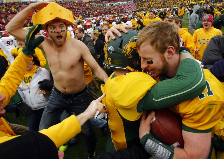 North Dakota State quarterbacks Carson Wentz (11) and Easton Stick (12) embrace after they defeated Jacksonville State 37-10 in the FCS championship NCAA college football game, Saturday, Jan. 9, 2016, in Frisco, Texas. (Mike Stone/Associated Press)