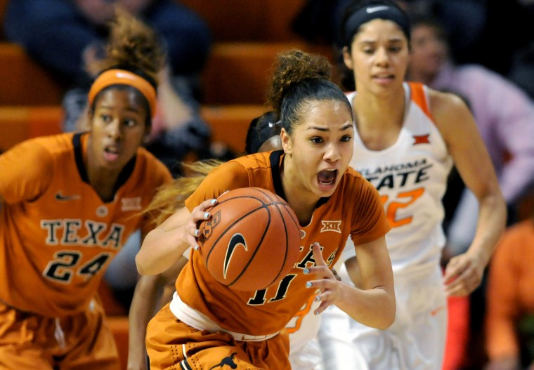 Texas guard Ariel Atkins, left, and Oklahoma State guard Brittney Martin, right, follow Texas guard Brooke McCarty, center, as she races down court with a stolen ball during the first half of an NCAA college basketball game in Stillwater, Okla., Saturday, Jan. 9, 2016. (Brody Schmidt/Associated Press)