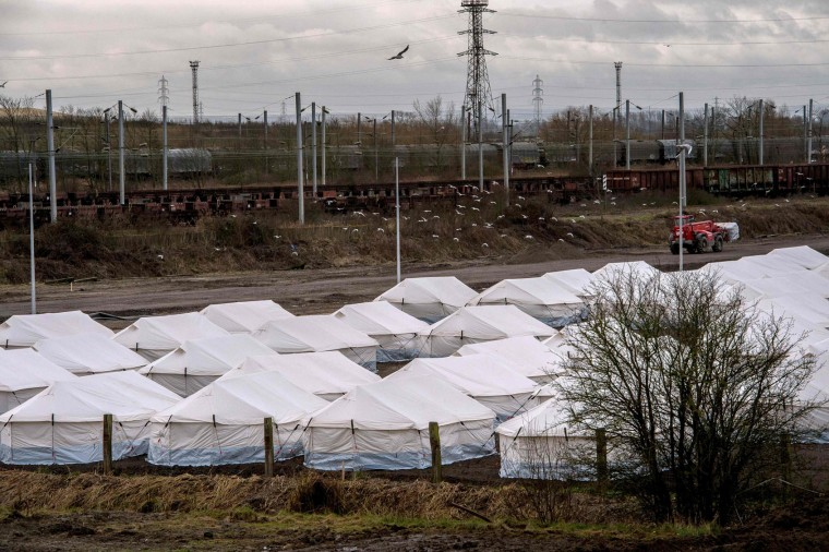 "This picture taken on February 4, 2016, shows a general view of a site where tents have been erected in a new camp in Grande-Synthe near Dunkirk in order to host the 3000 Iraqi Kurds and Syrians refugees and migrants currently living in poor conditions in the migrant camp known as the ""Jungle"" of Grande-Synthe, northern France. (Philippe Huguen/AFP/Getty Images)"