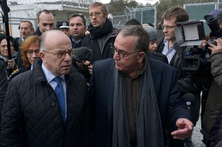 "French Interior Minister Bernard Cazeneuve is given a tour by the Greek Junior Interior Minister for Migration Ioannis Mouzalas at the ""Hot Spot"" in Moria , on the the northern Greek Aegean island of Lesbos, on February 4, 2016. Cazeneuve warned against ""a risk to Schengen"" if Europeans fail to move forward on the control of external borders during his visit to the island where many of the refugees and migrants arrive after crossing the sea from Turkey. He also assured the Greeks of the French government's ""solidarity"". (STR/AFP/Getty Images)"