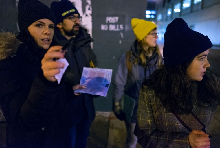 From left, Victoria Parker, Edward Casabian, Ashley Treni, and Alexis Sypek, all from New York and working with The Robin Hood Foundation, an organization that helps the poor, discuss their route as they take part in a count and survey of homeless persons on the streets of New York early Tuesday, Feb. 9, 2016. Hundreds of people fanned out across the city to conduct the survey just after midnight. (AP Photo/Craig Ruttle)