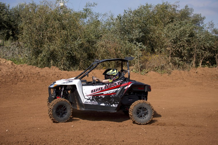 Israeli Minister of Culture and Sport Miri Regev drives an ATV during the inauguration of the first official Moto cross track the MX Wingate cross country race track near Netanya, Israel, Thursday, Feb. 11, 2016. (AP Photo/Ariel Schalit)