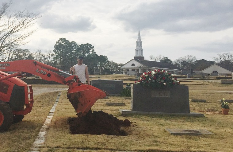 "Soil is placed in a grave in the Lee family cemetery plot, Saturday, Feb. 20, 2016, in Monroeville, Ala. Harper Lee, the author of ""To Kill a Mockingbird,"" died Friday, Feb. 19, 2016. She was 89. (AP Photo/Kim Chandler)"