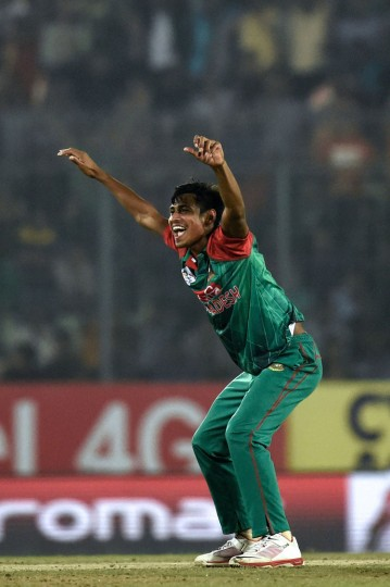 Bangladesh's Mustafizur Rahman successfully appeals for a Leg Before Wicket (LBW) decision against Sri Lanka's Thisara Perera during the Asia Cup T20 cricket tournament match between Bangladesh and Sri Lankaat at the Sher-e-Bangla National Cricket Stadium in Dhaka on February 28, 2016. (Munir uz Zaman/AFP/Getty Images)