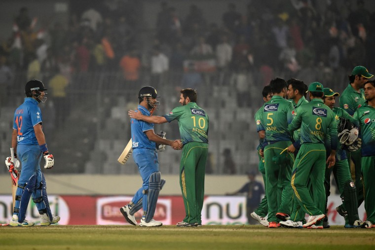 Pakistan's captain Shahid Afridi (C-R) congratulates India's captain Mahendra Singh Dhoni (C-L) at the end of the Asia Cup T20 cricket tournament match between India and Pakistan at the Sher-e-Bangla National Cricket Stadium in Dhaka on February 27, 2016. India trounced bitter rivals Pakistan by five wickets in a one-sided affair at the Asia Cup Twenty20 tournament. (Munir uz Zaman/AFP/Getty Images)