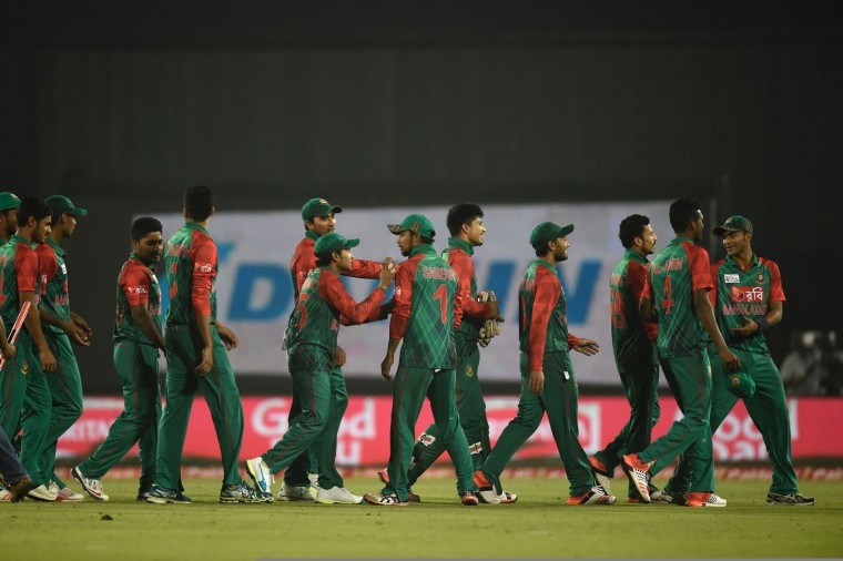 Bangladesh cricketers walk off the field after winning the match between Bangladesh and Sri Lanka at the Asia Cup T20 cricket tournament at the Sher-e-Bangla National Cricket Stadium in Dhaka on February 28, 2016. (Munir uz Zaman/AFP/Getty Images)