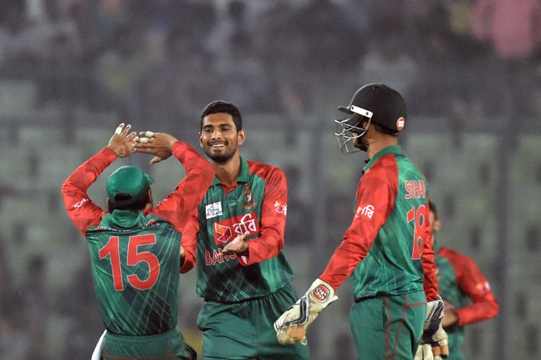 Bangladesh cricketer Mohammad Mahmudullah (2nd L) celebrates with his teammates after the dismissal of the United Arab Emirates cricketer Saqlain Haider during the match between Bangladesh and United Arab Emirates at the Asia Cup T20 (Twenty20) cricket tournament at the Sher-e-Bangla National Cricket Stadium in Dhaka on February 26, 2016. (Munir uz Zaman/AFP/Getty Images)