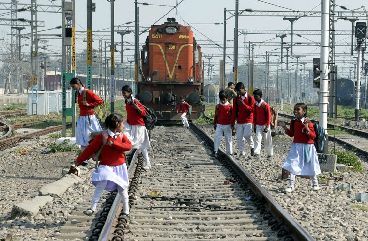 Indian schoolchildren cross rail tracks as they journey home after school, at Jalandhar city railway station in Jalandhar on February 24, 2016. Indian Railway minister Suresh Prabhu is set to announce the Indian Railways Budget on February 25. (SHAMMI MEHRA/AFP/Getty Images)