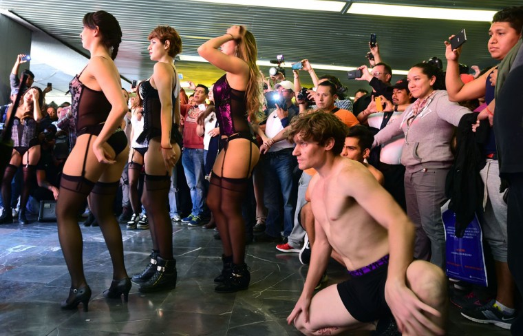 People take part in the worldwide 'No Pants Subway Ride' event in a subway station in Mexico City on February 21, 2016. Organized by New York City-based prank collective Improv Everywhere, the annual event was launched in 2002 and has since spread to more than 60 cities. (ALFREDO ESTRELLA/AFP/Getty Images)
