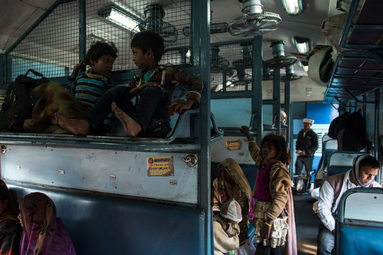 Indian children sit on the top seat of the wagon as they wait for a train to leave Hazrat Nizamuddin railway station in New Delhi on February 25, 2016. Indian Railway minister Suresh Prabhu is set to announce the Indian Railways Budget on February 25. (CHANDAN KHANNA/AFP/Getty Images)