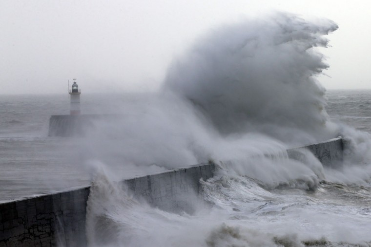 Waves hit a harbor wall on February 8, 2016 in Newhaven, East Sussex. Storm Imogen is the ninth named storm to hit the UK this season. This year's storms are being named in an effort by the Met Office and Met Eireann to increase public awareness and safety. They were named by public ballot and there are no names for the letters Q, U, X, Y and Z. (Photo by Carl Court/Getty Images)