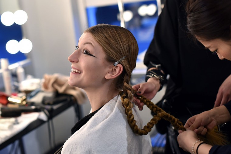 A model gets her hair done backstage at A Detacher fashion show during Fall 2016 New York Fashion Week at Pier 59 on February 11, 2016 in New York City. (Photo by Jacopo Raule/Getty Images)