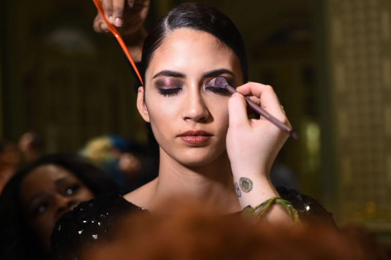 A model prepares backstage at the Binzario Couture Fashion Show during Fall 2016 New York Fashion Week at the Prince George Gallery on February 11, 2016 in New York City. (Photo by Ilya S. Savenok/Getty Images)