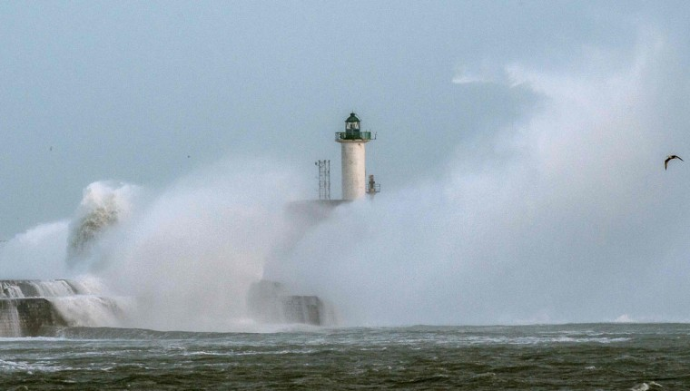 Waves break against the Boulogne-sur-mer harbor pier on February 8, 2016. (PHILIPPE HUGUEN/AFP/Getty Images)
