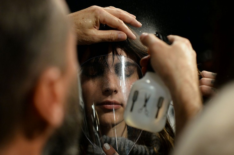 A model gets ready backstage to present Tadashi Shoji designs during the Fall 2016 New York Fashion Week at the Arcat Moynihan Station on February 12, 2016, in New York. (Jewel Samad/AFP/Getty Images)