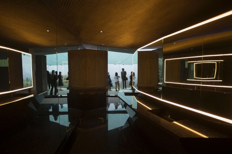 People walking through the office are seen from a bathroom during a tour of the John Lautner-designed home being donated to LACMA. (DAVID MCNEW/AFP/Getty Images)