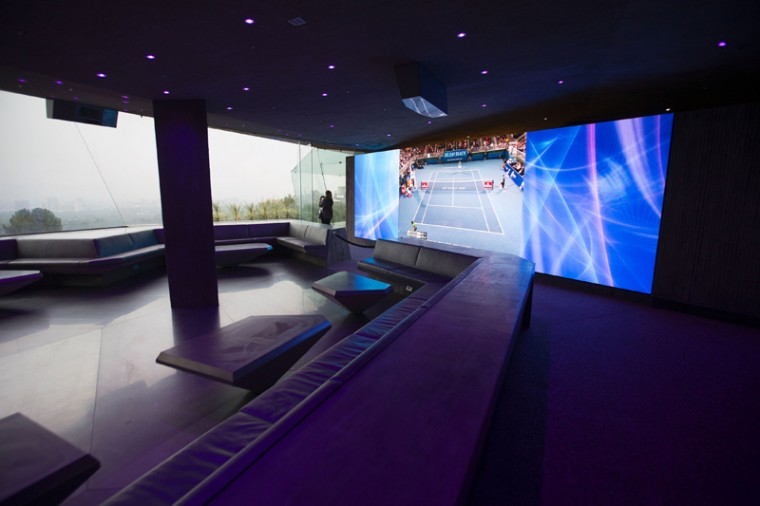 A giant television monitor makes up a wall of an entertainment room dubbed James Club (DAVID MCNEW/AFP/Getty Images)