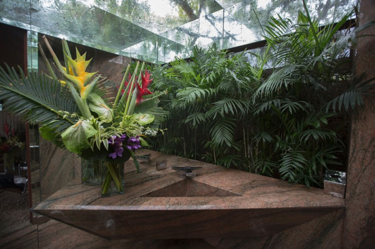 A guest bedroom sink with tropical foliage and a skylight is seen during the John Lautner-designed home. Lautner, behind many similarly unconventional homes, was a disciple of Frank Lloyd Wright. (DAVID MCNEW/AFP/Getty Images)