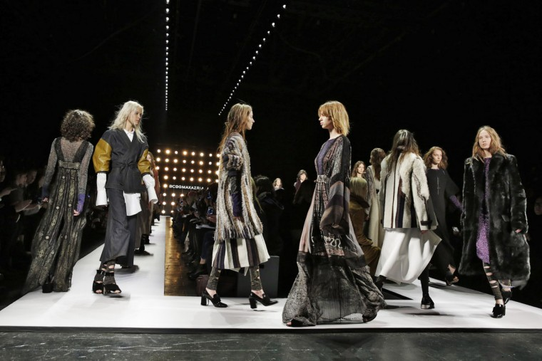Models walk in the finale of the BCBG MAX AZRIA Fall 2016 collection during Fashion Week in New York, Thursday, Feb. 11, 2016. (AP Photo/Richard Drew)