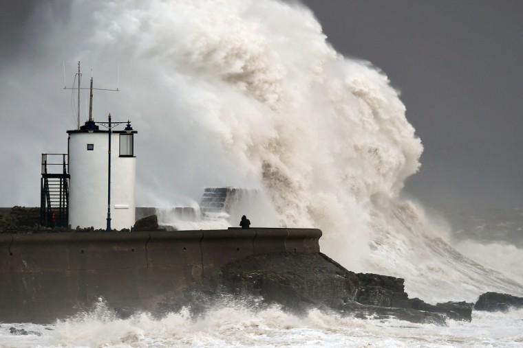 Waves crash over the sea wall at Porthcawl in Wales, Monday Feb. 8, 2016, as winds of nearly 100mph battered Britain after Storm Imogen slammed into the south coast bringing fierce gusts and torrential downpours. (Joe Giddens/PA via AP)