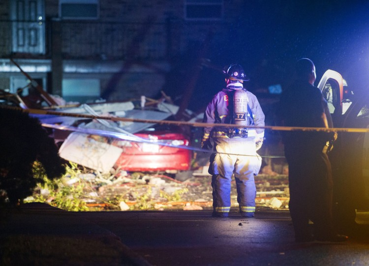 In this Feb. 23, 2016 photo, first responders inspect damage at the Moorings Apartments in Pensacola, Fla. In Florida, the National Weather Service said a tornado hit Pensacola, Fla. Meteorologist Steve Miller said the service has had many reports of property damage and people injured in storms Tuesday night. (Tony Giberson/Pensacola News Journal via AP)