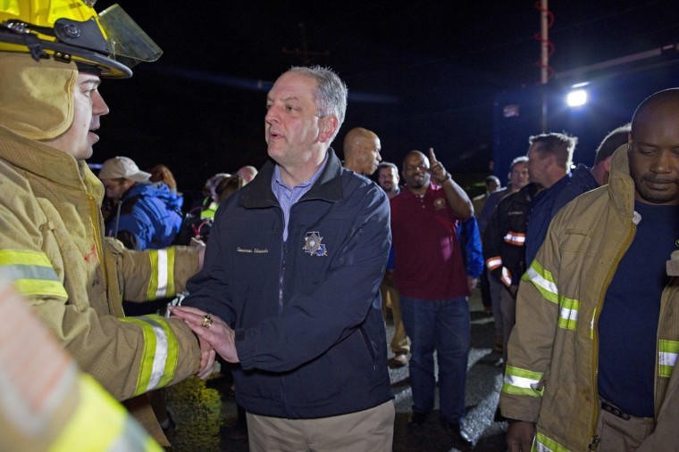 """Louisiana Governor John Bel Edwards thanks first responders after he toured the remains of trailers and vehicles after a suspected tornado hit the Sugar Hill RV Park in Convent, La., Tuesday, Feb. 23, 2016. Edwards described the scene as a """"jumbled mess."""" """"We all need to be prayerful and mindful and take those tornado warnings when we see them very seriously,"""" Edwards said. (AP Photo/Max Becherer)"""
