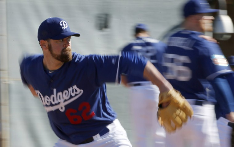 Los Angeles Dodgers pitcher Louis Coleman throws a pitch during a spring training baseball workout Monday Glendale, Ariz. (Ross D. Franklin/AP)