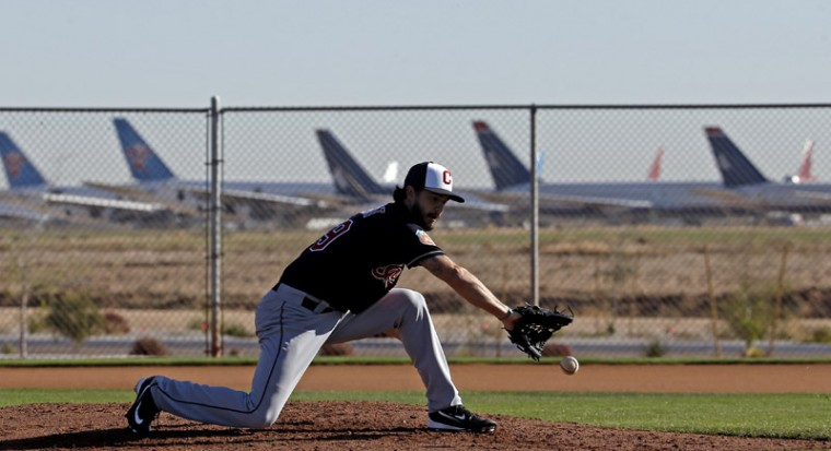The Cleveland Indians' Ryan Merritt fields a ground ball during a spring training baseball workout on Monday in Goodyear, Ariz. (Morry Gash/AP)