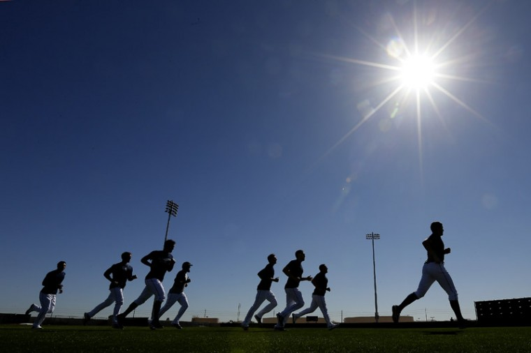 Players for the Seattle Mariners run sprints during spring training baseball practice on Monday in Peoria, Ariz. (Charlie Riedel/AP)