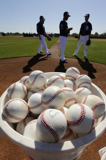 Players for the San Diego Padres wait to participate in a drill during spring training baseball practice Monday in Peoria, Ariz. (Charlie Riedel/AP)