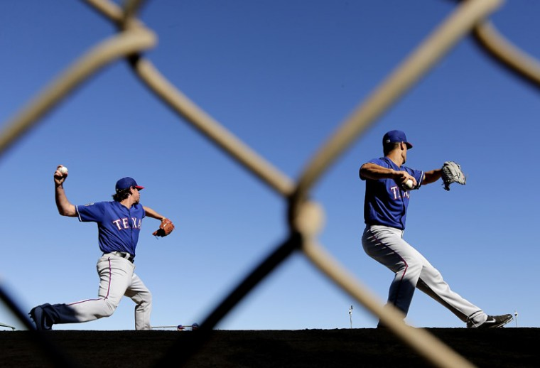Texas Rangers pitchers Nick Tepesch, left, and Jeremy Guthrie throw during spring training baseball practice Sunday in Surprise, Ariz. (Charlie Riedel/AP)