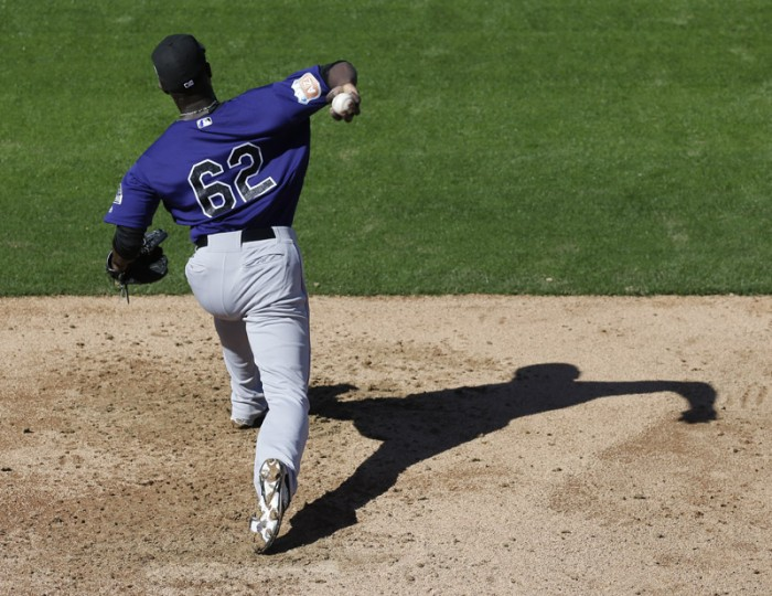 Colorado Rockies relief pitcher Gonzalez Germen throws during spring training baseball practice in Scottsdale, Ariz., on Monday. (Chris Carlson/AP)