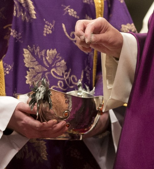 Pope Francis, right, takes the ashes during the Ash Wednesday mass, in St. Peter's Basilica at the Vatican, Wednesday, Feb. 10, 2016. Pope Francis has smudged ashes on the bowed heads of prelates, nuns and ordinary Catholics during Ash Wednesday Mass in St. Peter's Basilica. The ritual marks the start of Lent, a period of penitence, prayer and self-sacrifice as faithful prepare for Easter. (AP Photo/Alessandra Tarantino)