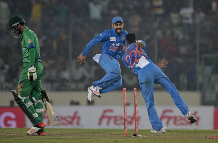 India''s Hardik Pandya, right, celebrates with his teammate Virat Kohli, center, after the dismissal of Pakistan''s Mohammad Amir, left, during their Asia Cup Twenty20 international cricket match in Dhaka, Bangladesh, Saturday, Feb. 27, 2016. (AP Photo/A.M. Ahad)
