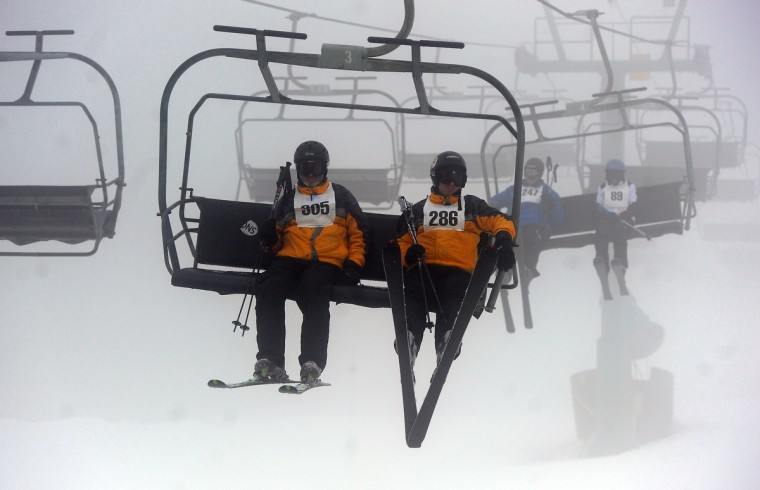 Skiers ride the lift on a foggy afternoon at the winter 2016 Maryland Special Olympics, which was held at Whitetail Ski Resort.  (Barbara Haddock Taylor/Baltimore Sun)