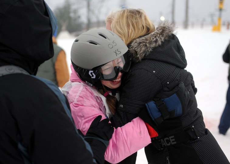 Tetyana Bielaeva, left, of the eastern shore gets a hug from Betsy Silver, right, at the winter 2016 Maryland Special Olympics, which was held at Whitetail Ski Resort. She had just completed the super glide event.  (Barbara Haddock Taylor/Baltimore Sun)