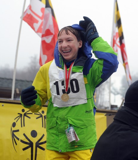 Sam Shay, 14 of Crownsville, looks happy on the medal stand after winning a gold medal in skiing at the winter 2016 Maryland Special Olympics, which was held at Whitetail Ski Resort.  (Barbara Haddock Taylor/Baltimore Sun)