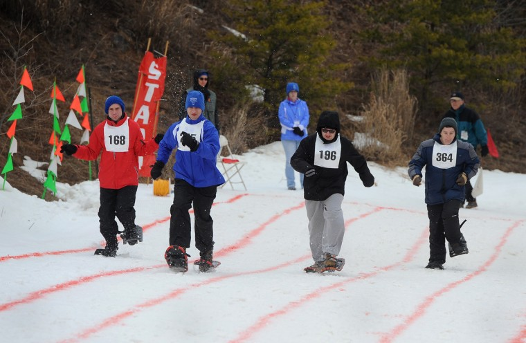 Participants in a snowshoe race run toward the fininsh line at the winter 2016 Maryland Special Olympics, which was held at Whitetail Ski Resort.  (Barbara Haddock Taylor/Baltimore Sun)